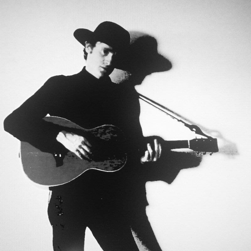 Black and White Image of Ethan Gold with Guitar